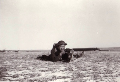 Willie Chong with a rifle during basic training