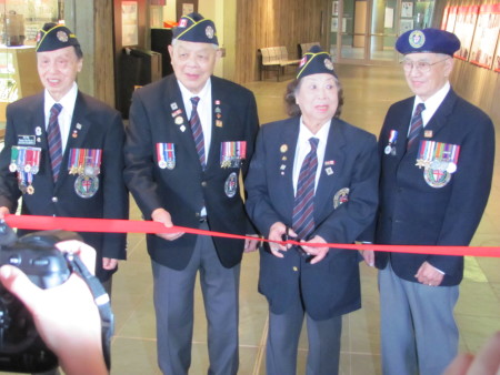 WWII veterans (from left to right) Ed Lee; George Chow, Peggy Lee and Frank Wong cut the ribbon the the One War, Two Victories exhibition.