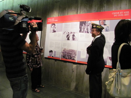 WWII veteran Ed Lee, points to a photo of himself taken while he was stationed in India.