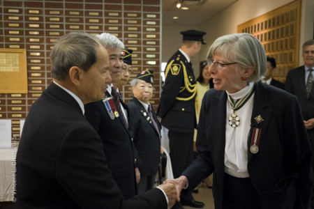 WWII veteran Tommy Wong meets Lieutenant Governor Judith Guichon while another WWII veteran, Peggy Lee, looks on.