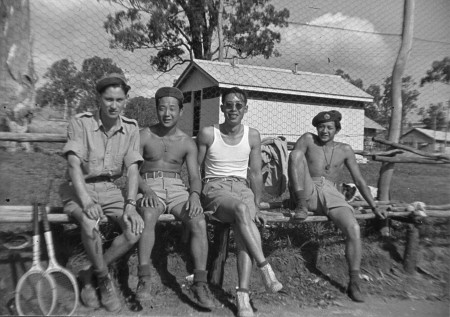 Harden Lee (second from left) enjoys a break playing tennis.