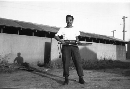 Harden Lee playing with a Japanese sword (Australia 1945)