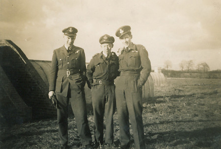 Photo of RCAF crew of DV-245 Lancaster MK III. Individuals left to right are F/O Wm. Brooks (Edmonton, AB), F/O Jim Gen Lee (Winnipeg, MB), F/O Ralph Robert Little (Lockport, NY).