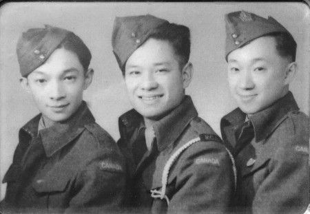 Victor E. Wong (centre) with his two cousins Leonard Lee (L) and Howard Lee.
