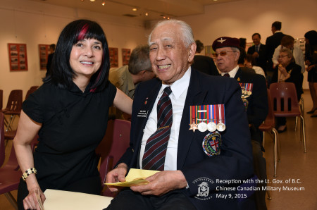 Curator and exhibition designer Catherin Clement chats with WWII veteran Neil Chan.