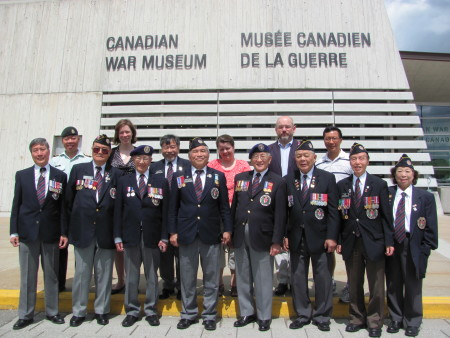 Chinese Canadian veterans delegation poses with Canadian War Museum and other supporters.