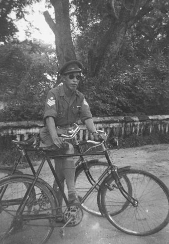 Donald Sung (Force 136 India) on his bicycle and holding the bike of his cousin Young Ming (James) Wong.