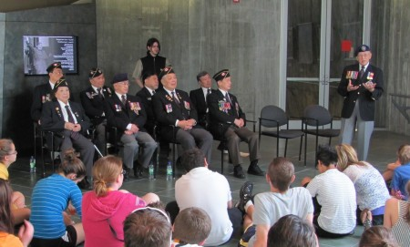 Chinese Canadian veterans meet with high school students and share their stories of the double victory.