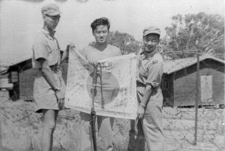 At Liverpool Rest Camp: Eddie Chow in the middle