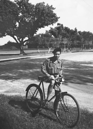 Young Ming (James) Wong in India with a bicycle